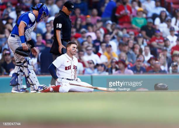 Enrique Hernandez of the Boston Red Sox looks towards the pitchers mound after being hit by a pitch in the bottom of the seventh inning of the game...