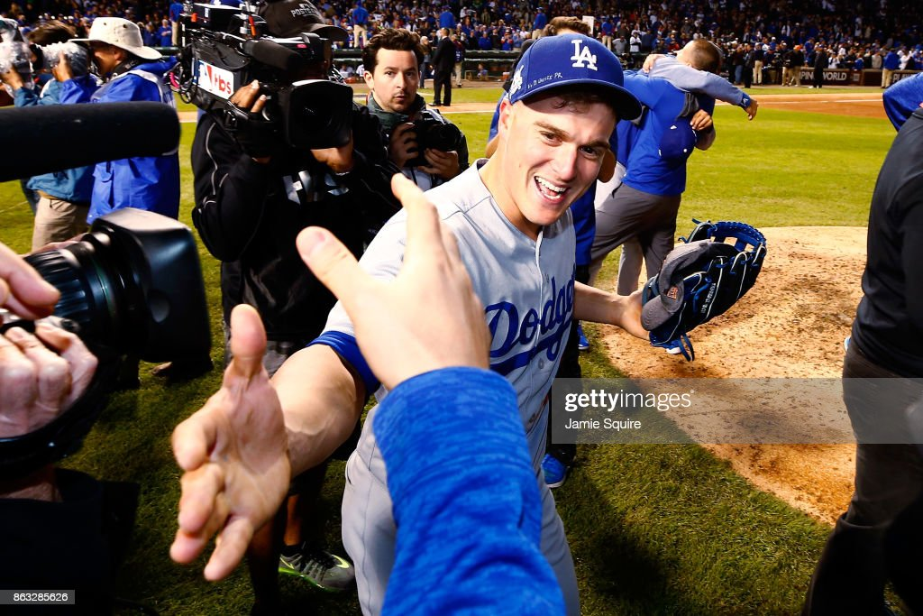 Enrique Hernandez #14 of the Los Angeles Dodgers celebrates after beating the Chicago Cubs 11-1 in game five of the National League Championship Series at Wrigley Field on October 19, 2017 in Chicago, Illinois. The Dodgers advance to the 2017 World Series.