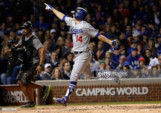 Enrique Hernandez of the Los Angeles Dodgers celebrates after hitting a home run in the second inning against the Chicago Cubs during game five of...