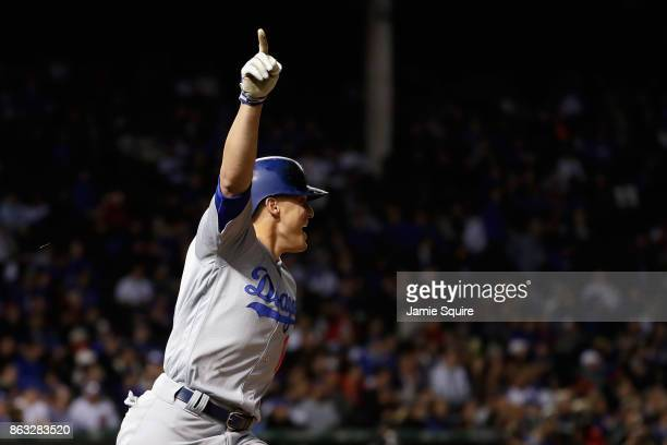 Enrique Hernandez of the Los Angeles Dodgers celebrates after hitting a tworun home run in the ninth inning against the Chicago Cubs during game five...
