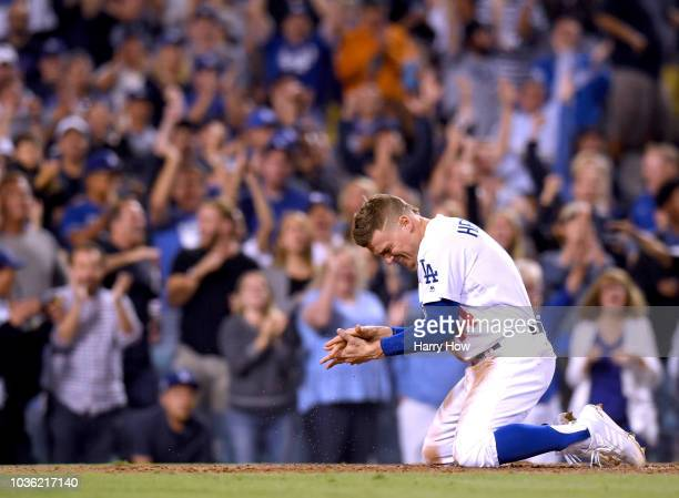 Enrique Hernandez of the Los Angeles Dodgers celebrates his run to tie the Colorado Rockies 22 during the fifth inning at Dodger Stadium on September...