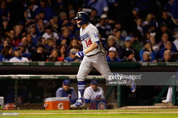 Enrique Hernandez of the Los Angeles Dodgers celebrates while rounding the bases after hitting a grand slam in the third inning against the Chicago...