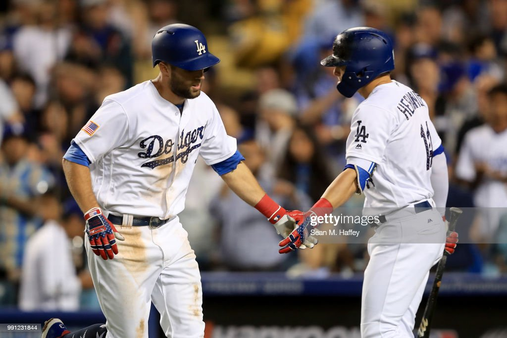 Enrique Hernandez #14 of the Los Angeles Dodgers congratulates Chris Taylor #3 after his solo home run during the fourth inning of a game against the Pittsburgh Pirates at Dodger Stadium on July 3, 2018 in Los Angeles, California.