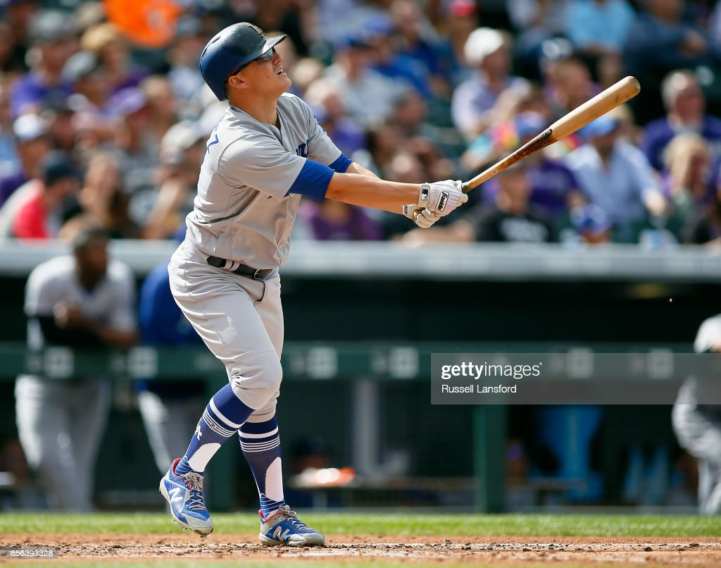 Enrique Hernandez #14 of the Los Angeles Dodgers connects for an RBI sacrifice fly during the third inning of a regular season MLB game between the Colorado Rockies and the visiting Los Angeles Dodgers at Coors Field on October 1, 2017 in Denver, Colorado.