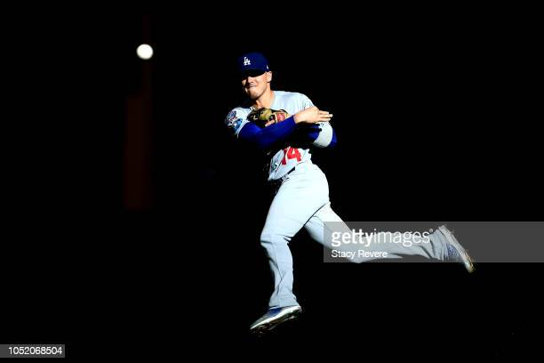 Enrique Hernandez of the Los Angeles Dodgers fields the ball against the Milwaukee Brewers during the first inning in Game Two of the National League...