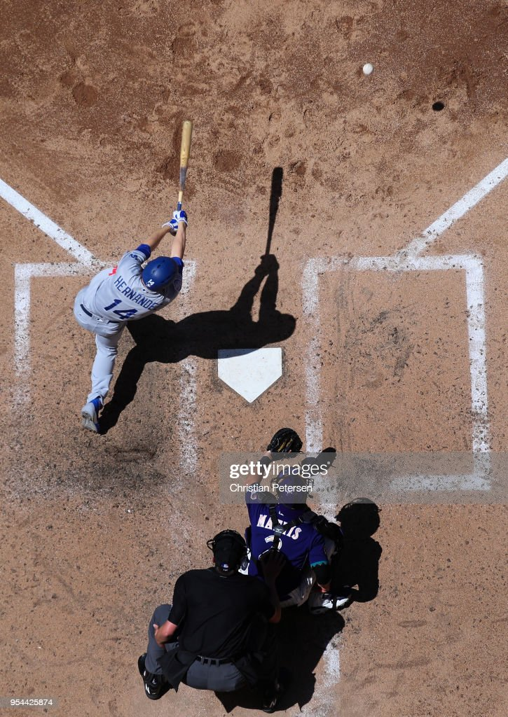 Enrique Hernandez #14 of the Los Angeles Dodgers hits a ground ball out against the Arizona Diamondbacks during the sixth inning of the MLB game at Chase Field on May 3, 2018 in Phoenix, Arizona. The Dodgers defeated the Diamondbacks 5-2.