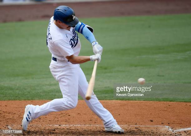 Enrique Hernandez of the Los Angeles Dodgers hits a three run home run against pitcher Antonio Senzatela of the Colorado Rockies during the fourth...