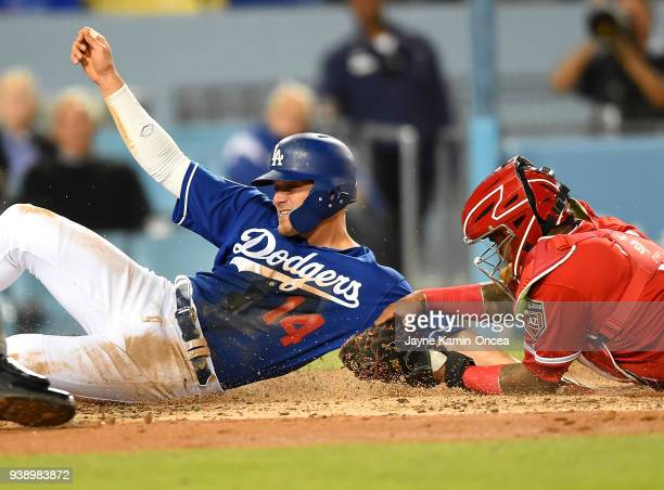 Enrique Hernandez of the Los Angeles Dodgers is tagged out at home by Martin Maldonado of the Los Angeles Angels of Anaheim in the second inning of...