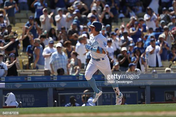 Enrique Hernandez of the Los Angeles Dodgers jogs home after hitting a solo gametying homerun against pitcher Will Smith of the Milwaukee Brewers in...