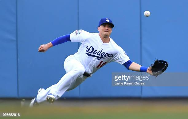 Enrique Hernandez of the Los Angeles Dodgers makes a catch off a ball hit by Buster Posey of the San Francisco Giants in the first inning of the game...