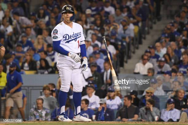 Enrique Hernandez of the Los Angeles Dodgers reacts after striking out during the eighth inning against the Milwaukee Brewers in Game Three of the...