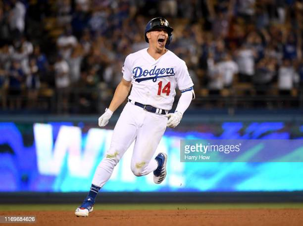 Enrique Hernandez of the Los Angeles Dodgers reacts to his walk off single for a 3-2 win over the Toronto Blue Jays during the ninth inning at Dodger...