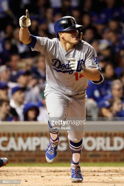 Enrique Hernandez of the Los Angeles Dodgers reacts to hitting a grand slam in the third inning against the Chicago Cubs during game five of the...