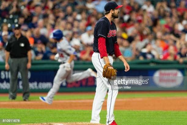 Enrique Hernandez of the Los Angeles Dodgers rounds the bases on a solo home run off relief pitcher Andrew Miller of the Cleveland Indians during the...