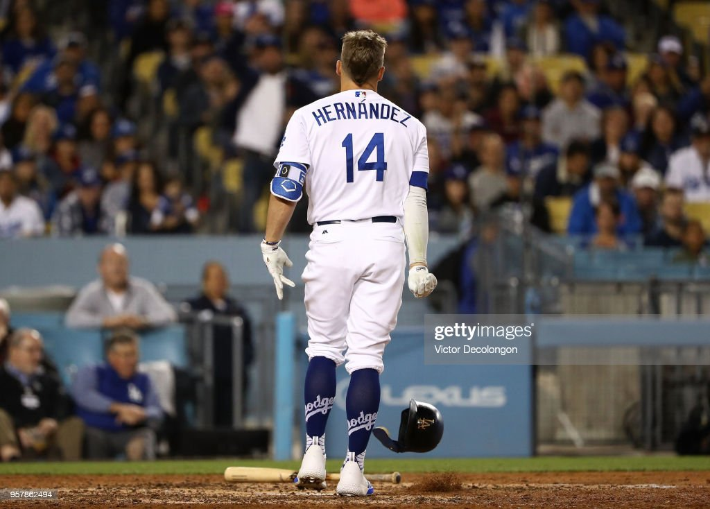 Enrique Hernandez #14 of the Los Angeles Dodgers throws his helmet to the ground after he struck out looking to end the seventh inning during the MLB game against the Cincinnati Reds at Dodger Stadium on May 12, 2018 in Los Angeles, California. The Reds defeated the Dodgers 5-3.