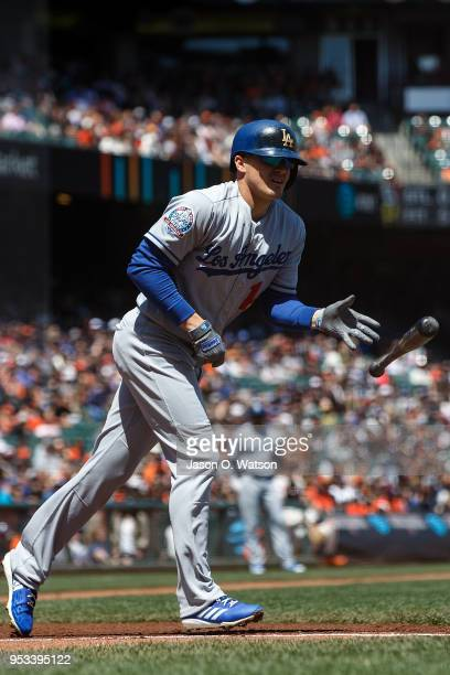 Enrique Hernandez of the Los Angeles Dodgers tosses his bat after getting hit by a pitch against the San Francisco Giants during the first inning at...