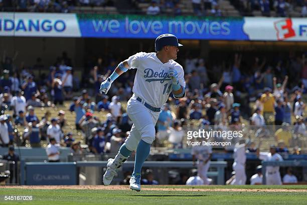 Enrique Hernandez of the Los Angeles Dodgers watches the ball leave the park for a solo gametying homerun against pitcher Will Smith of the Milwaukee...