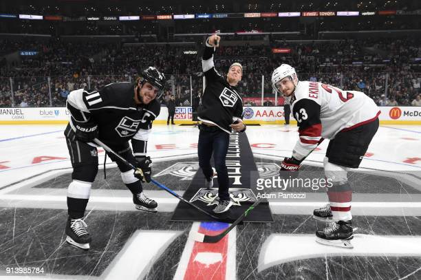 Enrique Hernández of the Los Angeles Dodgers participates in a ceremonial puck drop with Anze Kopitar of the Los Angeles Kings and Oliver...
