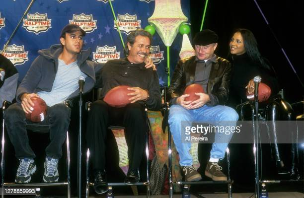 Enrique Iglasias, Edward James Olmos, Phil Collins and Toni Braxton participate in a press conference before he performs during the Super Bowl XXXIV...