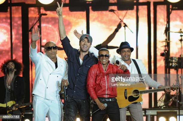 Enrique Iglesias and Gente de Zona perform onstage during the 2014 Billboard Latin Music Awards at Bank United Center on April 24 2014 in Miami...