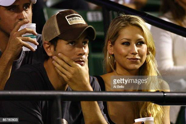 Enrique Iglesias and girlfriend Anna Kournikova watch as Venus Williams plays her semifinal match against Serena Williams at the Sony Ericsson Open...