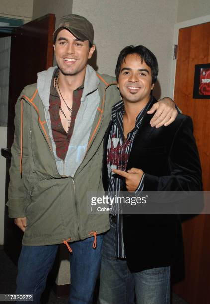 Enrique Iglesias and Luis Fonsi during A Very Special Christmas Una Noche de Paz Reception and Backstage at Arrowhead Pond in Anaheim California...