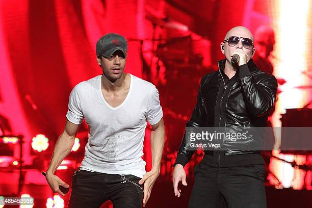 Enrique Iglesias and Pitbull perform on stage at Coliseo Jose M Agrelot on March 6 2015 in San Juan Puerto Rico