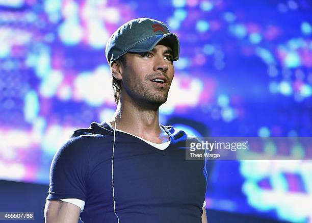 Enrique Iglesias and Pitbull with special guest J Balvin perform at opening night of U.S. Tour at Prudential Center on September 12, 2014 in Newark,...