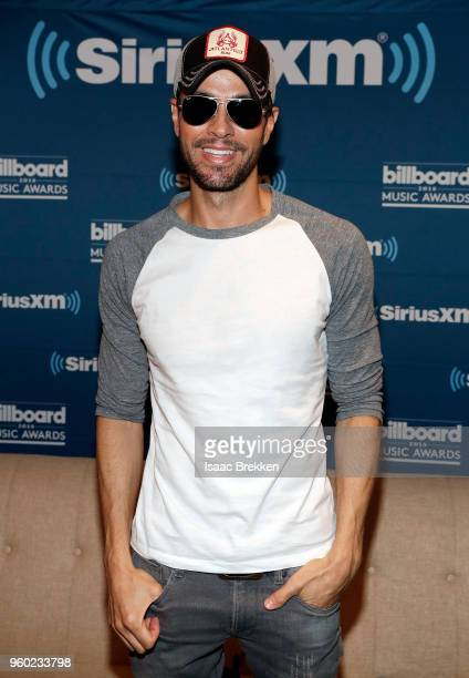 Enrique Iglesias attends The Morning Mash Up on SiriusXM Hits 1 backstage broadcast leading up to the Billboard Music Awards on May 19, 2018 in Las...
