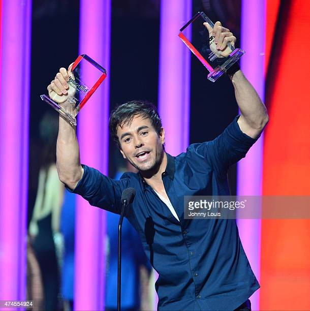 Enrique Iglesias onstage accepting award during the 2015 Billboard Latin Music Awards presented by State Farm on Telemundo at Bank United Center on...