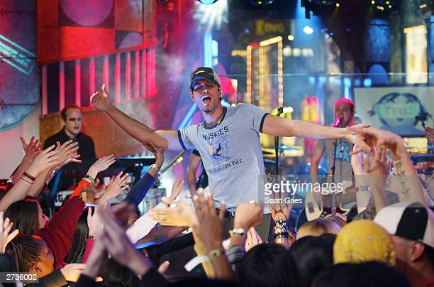 Enrique Iglesias performs on stage during 'Spankin' New Music Week' on MTV's Total Request Live at the MTV Times Square Studios November 14 2003 in...