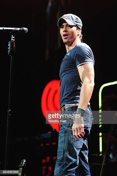 Enrique Iglesias performs onstage during 1035 KISS FM's Jingle Ball 2013 presented by Jam Audio Collection at United Center on December 9 2013 in...