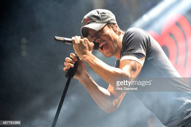 Enrique Iglesias performs onstage during 933 FLZ's Jingle Ball 2013 at the Tampa Bay Times Forum on December 18 2013 in Tampa Florida