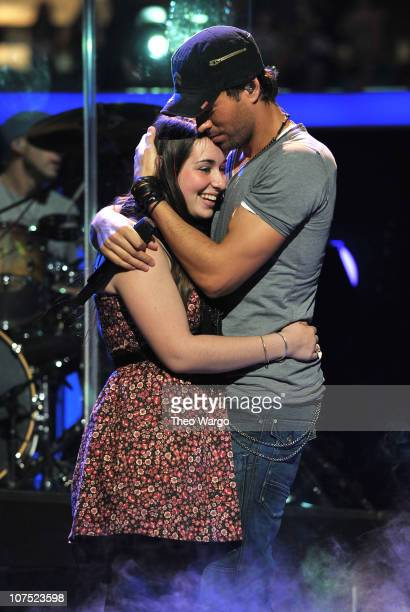 Enrique Iglesias performs onstage with a fan during Z100's Jingle Ball 2010 presented by HM at Madison Square Garden on December 10 2010 in New York...