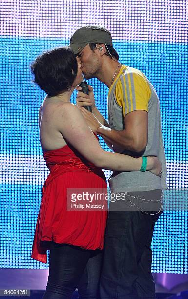 Enrique Iglesias performs with and kisses a 16 year old fan at the Cheerios Childline Concert in the The O2 on December 16 2008 in Dublin Ireland