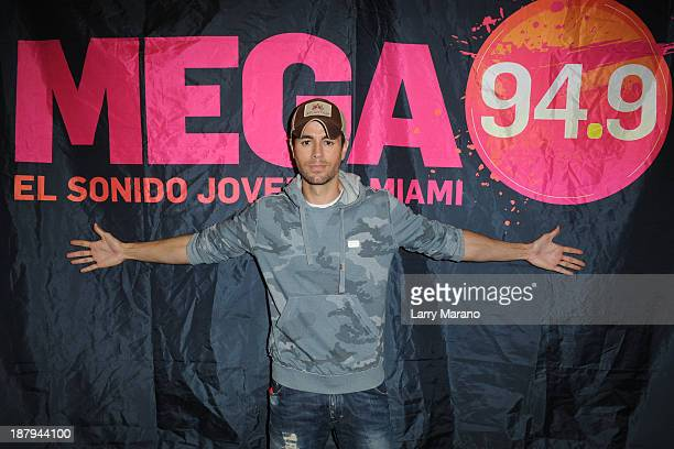 Enrique Iglesias visits MEGA 949 Radio Station at MEGA 949 Radio Station on November 13 2013 in Miami Florida