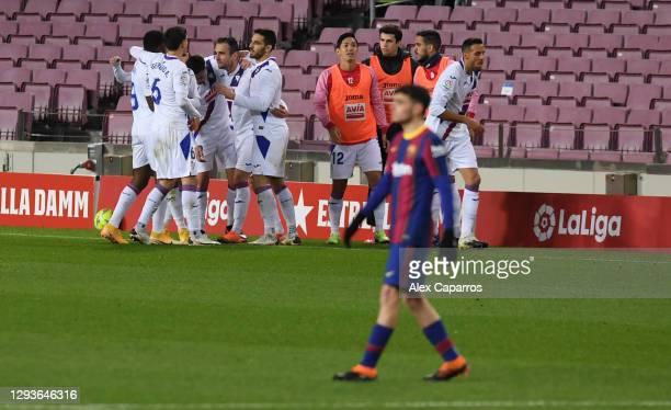 Enrique 'Kike' Garcia of SD Eibar celebrates with his teammates after he scores their first goal of the game during the La Liga Santander match...