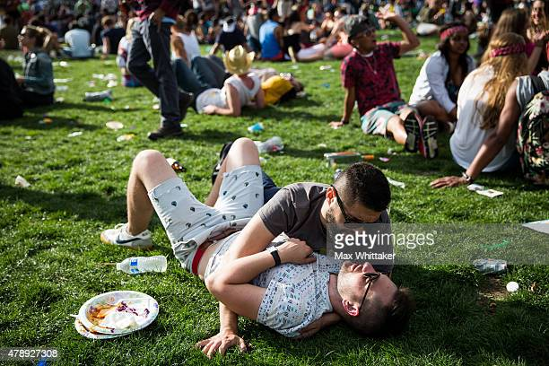 Enrique Martinez, top, and Grant Willis embrace on the lawn of City Hall after the San Francisco Gay Pride Parade, June 28, 2015 in San Francisco,...