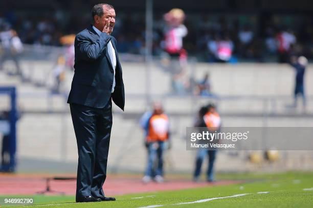 Enrique Meza coach of Puebla gestures during the 15th round match between Pumas UNAM and Puebla as part of the Torneo Clausura 2018 Liga MX at...
