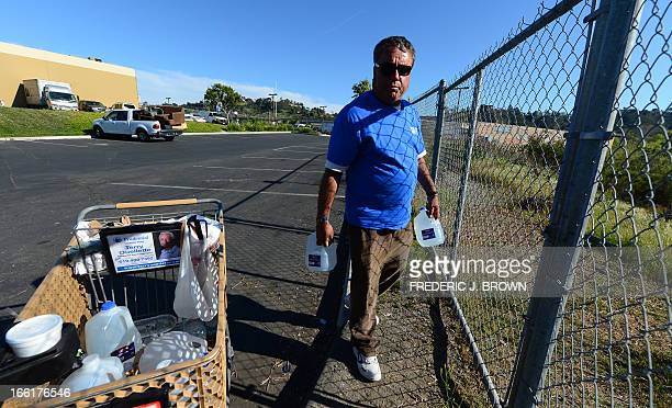 Enrique Mornones, an advocate for social justice , prepares to deliver water to the homeless and undocumented in San Diego, California on April 4,...