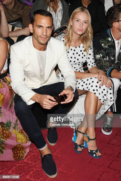 Enrique Palacios and Adriana Cernanova attend the Dolce Gabbana show during Milan Men's Fashion Week Spring/Summer 2018 on June 17 2017 in Milan Italy