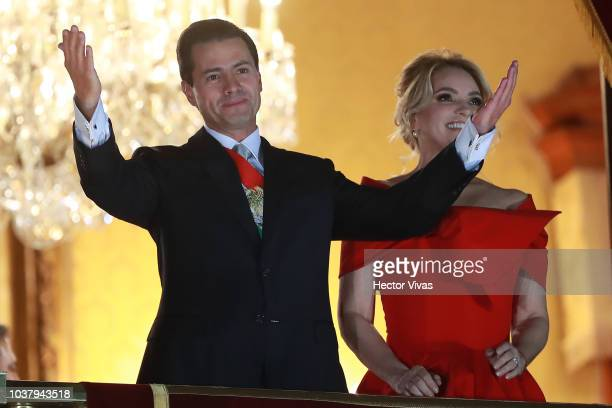 Enrique Peña Nieto president of Mexico greets with his wife Angelica Rivera during the Mexico Independence Day Celebrations at Zocalo on September 15...