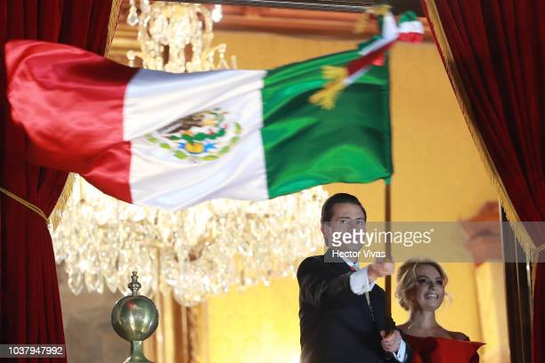 Enrique Peña Nieto President of Mexico waves a Mexican flag during the Mexico Independence Day Celebrations at Zocalo on September 15 2018 in Mexico...