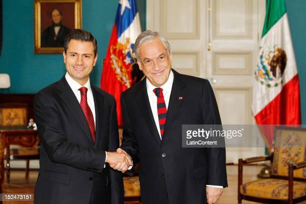 Enrique Peña Nieto Presidentelect of Mexico greets Chilean president Sebastian Piñera at Palacio de La Moneda during his visit to Chile on September...