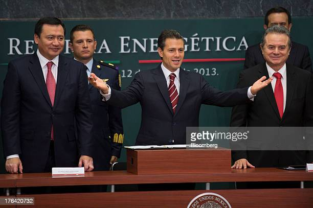 Enrique Pena Nieto Mexico's president center gestures as he stands with Miguel Angel Osorio Chong minister of the interior left and Joaquin Coldwell...