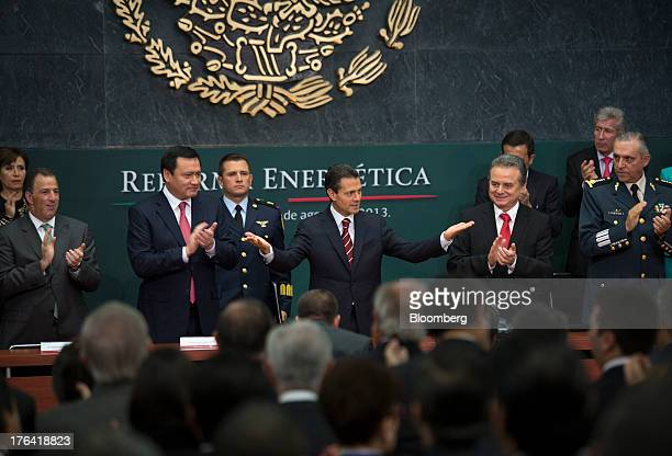 Enrique Pena Nieto Mexico's president center gestures while making an announcement on energy reform with Jose Antonio Meade minister of foreign...