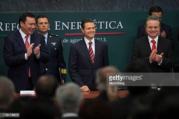 Enrique Pena Nieto Mexico's president center Miguel Angel Osorio Chong minister of the interior left and Joaquin Coldwell minister of energy smile...