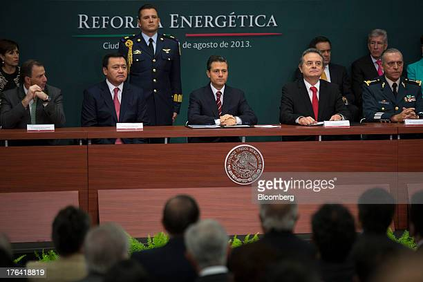 Enrique Pena Nieto Mexico's president center sits with Jose Antonio Meade minister of foreign affairs left Miguel Angel Osorio Chong minister of the...