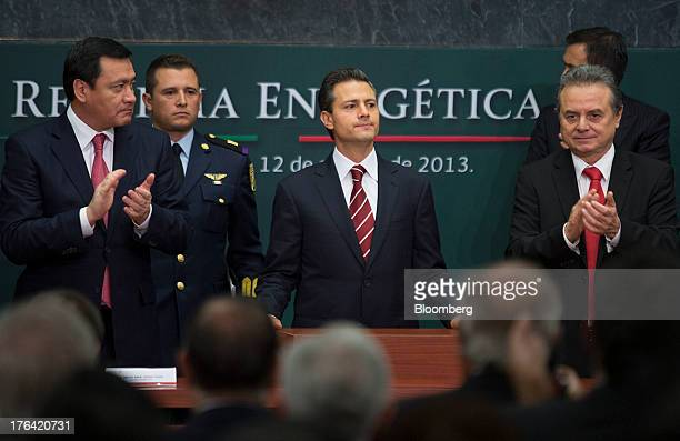 Enrique Pena Nieto Mexico's president center stands with Miguel Angel Osorio Chong minister of the interior left and Joaquin Coldwell minister of...