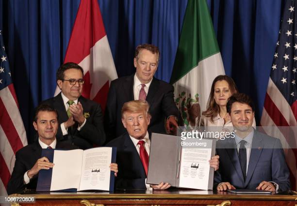 Enrique Pena Nieto Mexico's president from front left US president Donald Trump and Justin Trudeau Canada's prime minister sit for photographs as...